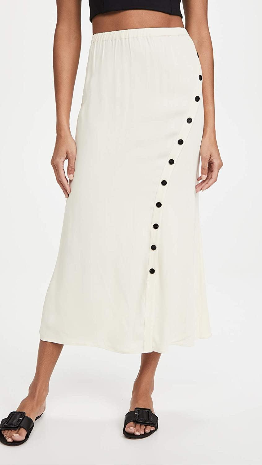 <p>This cozy <span>Self Portrait Crepe Button Midi Skirt</span> ($340) would look perfect with a crop top.</p>