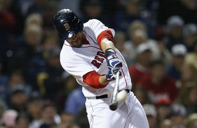 Boston Red Sox's J.D. Martinez hits a three-run home run during the fifth inning of a baseball game against the Houston Astros in Boston, Sunday, Sept. 9, 2018. (AP Photo/Michael Dwyer)
