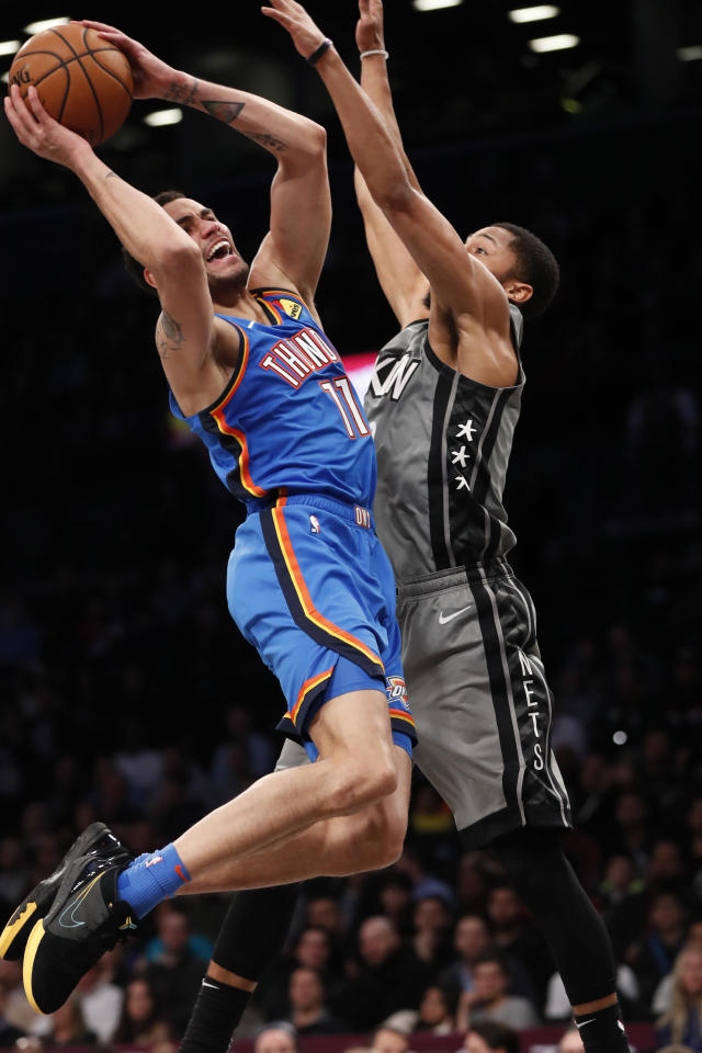 Brooklyn Nets guard Spencer Dinwiddie, right, defends Oklahoma City Thunder forward Abdel Nader (11) as Nader goes up for a layup during the first half of an NBA basketball game, Tuesday, Jan. 7, 2020, in New York. (AP Photo/Kathy Willens)
