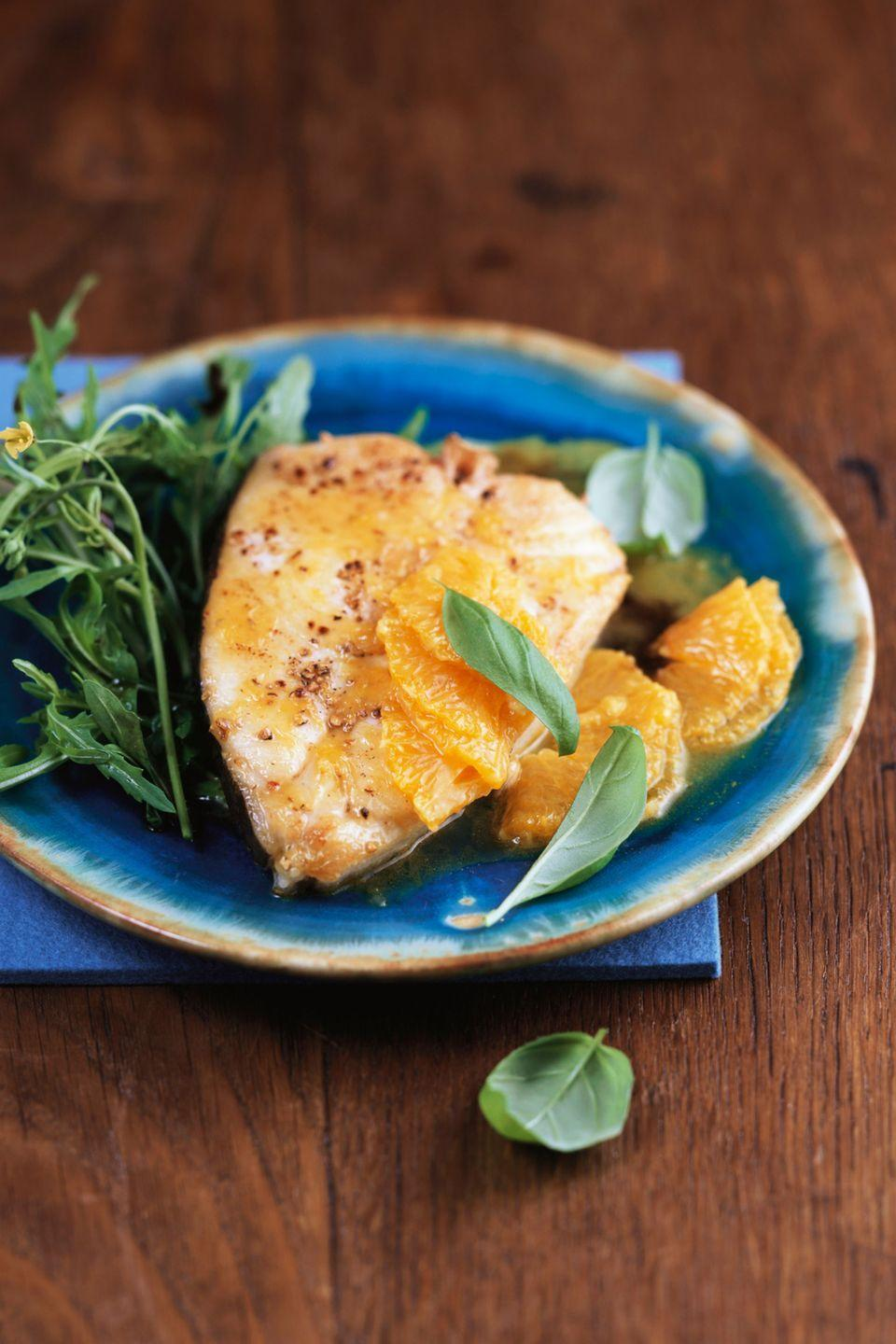 "<p>Since it's packed with protein and under 300 calories, it's hard to find a recipe that's more filling and delicious.</p><p><a href=""https://www.womansday.com/food-recipes/food-drinks/recipes/a10276/roasted-halibut-orange-salsa-121582/"" rel=""nofollow noopener"" target=""_blank"" data-ylk=""slk:Get the Halibut with Spinach, Oranges and Olives recipe."" class=""link rapid-noclick-resp""><em><strong>Get the Halibut with Spinach, Oranges and Olives recipe.</strong></em></a></p>"