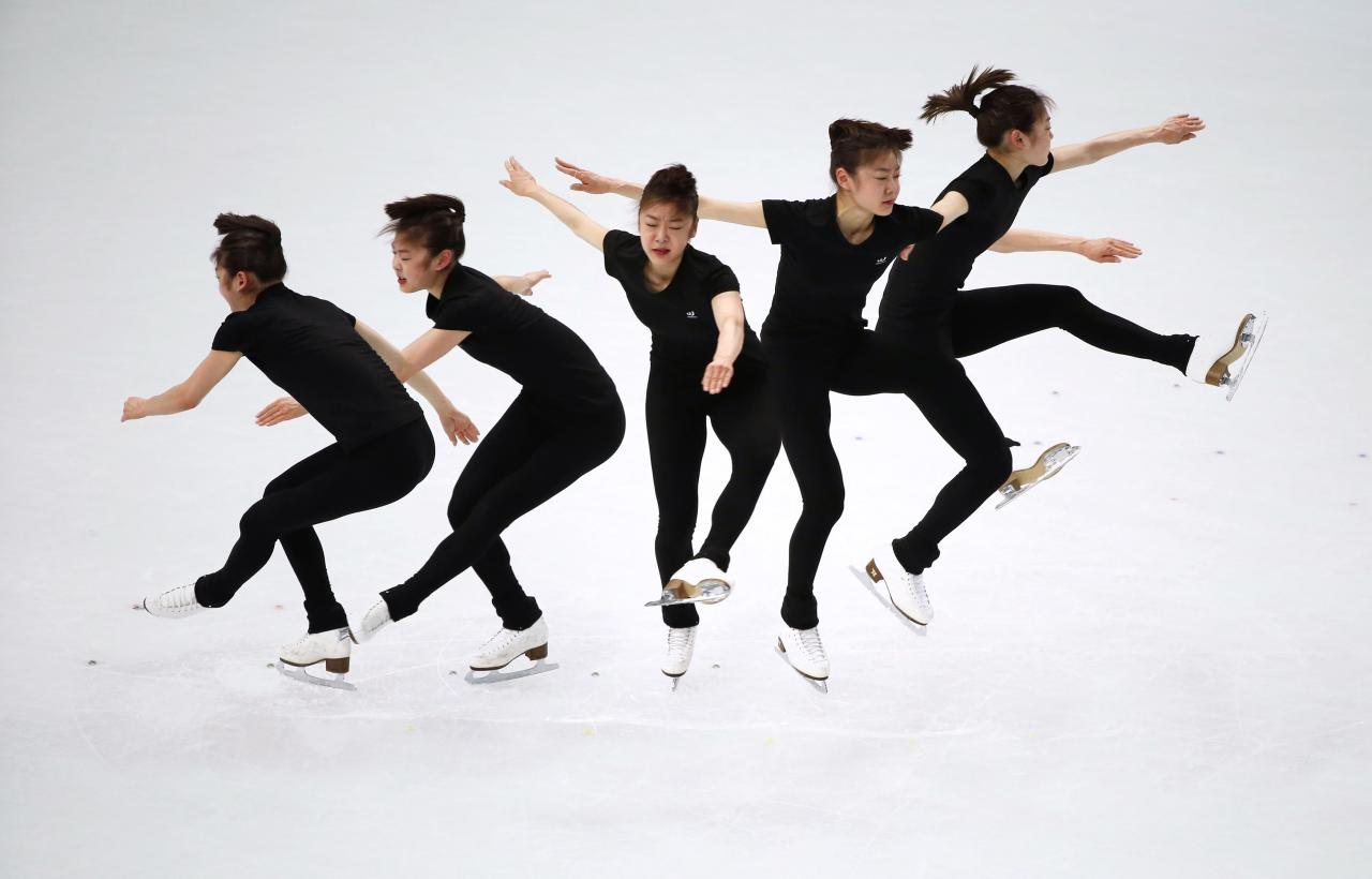 Kim Yuna of South Korea practices her routine during a figure skating training session at the Iceberg Skating Palace during the 2014 Sochi Winter Olympics February 18, 2014. Picture taken with multiple exposure. REUTERS/Lucy Nicholson (RUSSIA - Tags: SPORT FIGURE SKATING OLYMPICS)