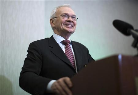 Wilson president and CEO of Agrium smiles after the company's annual general meeting in Calgary.