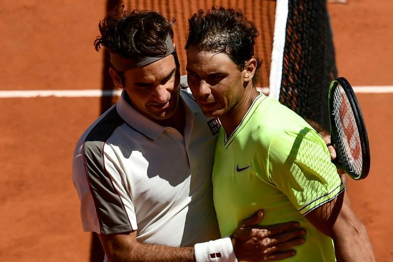 Great rivals: Roger Federer with Rafael Nadal after losing in the 2019 semi-finals