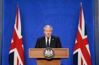 FILE PHOTO: Britain's Prime Minister Boris Johnson speaks at a news conference in London