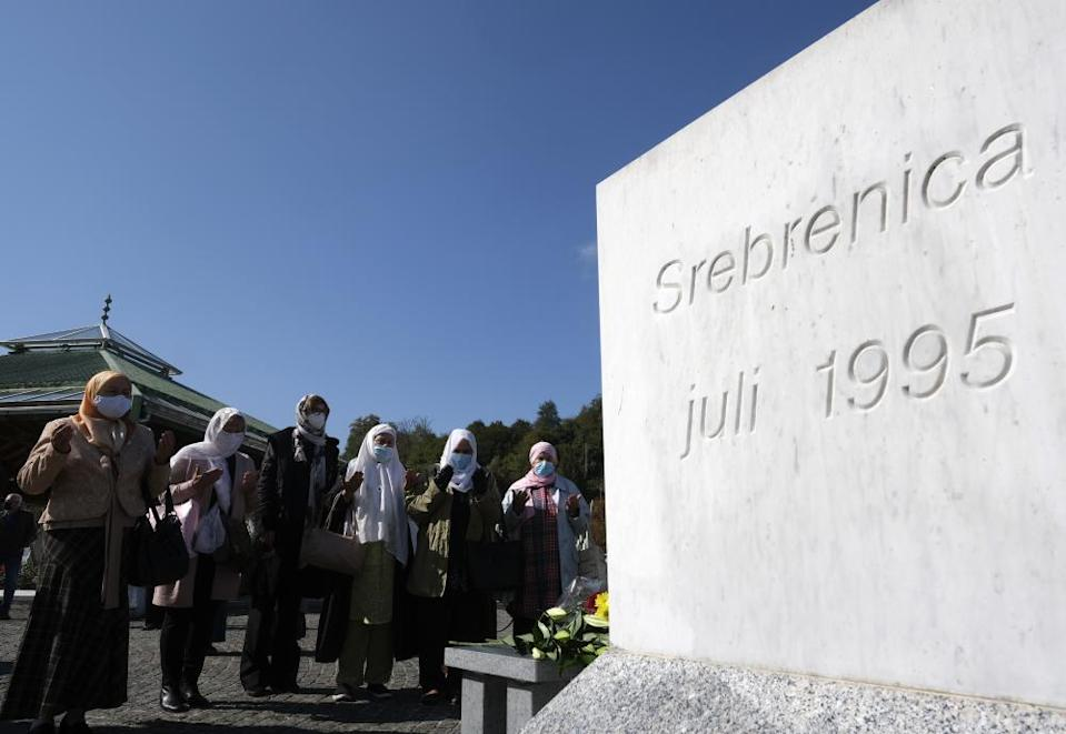 Žbanić , third left, prays at the memorial cemetery in Potocari, before the first public showing of Quo Vadis, Aida?
