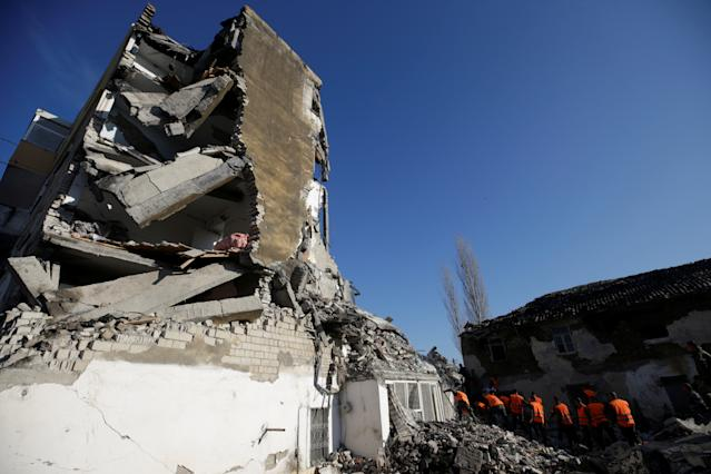 Emergency personnel work near a damaged building in the Albanian town of Thumane (Reuters)