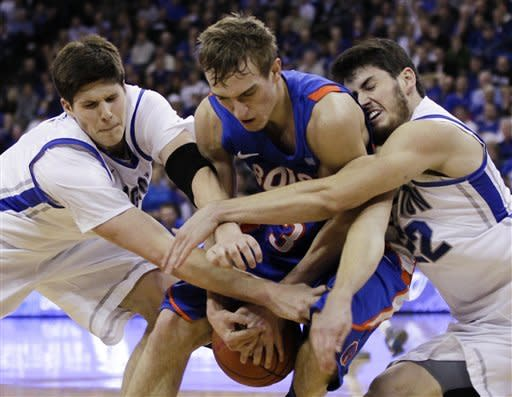Boise State's Anthony Drmic, center, struggles for the ball against Creighton's Doug McDermott, left, and Avery Dingman during the second half of an NCAA college basketball game in Omaha, Neb., Wednesday, Nov. 28, 2012. (AP Photo/Nati Harnik)