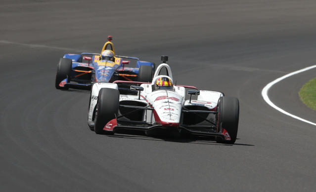 Oriol Servia, of Spain, leads Alexander Rossi through a turn during the Indianapolis 500 auto race at Indianapolis Motor Speedway in Indianapolis, Sunday, May 27, 2018. (AP Photo/AJ Mast)