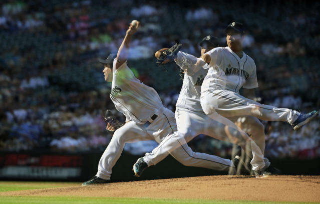 In this multiple exposure, Seattle Mariners starting pitcher Yusei Kikuchi throws to a San Diego Padres batter during the third inning of a baseball game, Wednesday, Aug. 7, 2019, in Seattle. (AP Photo/Ted S. Warren)