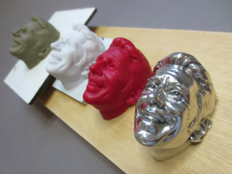 The progression of sculptures of Mario Andretti for the Baby Borg trophy.