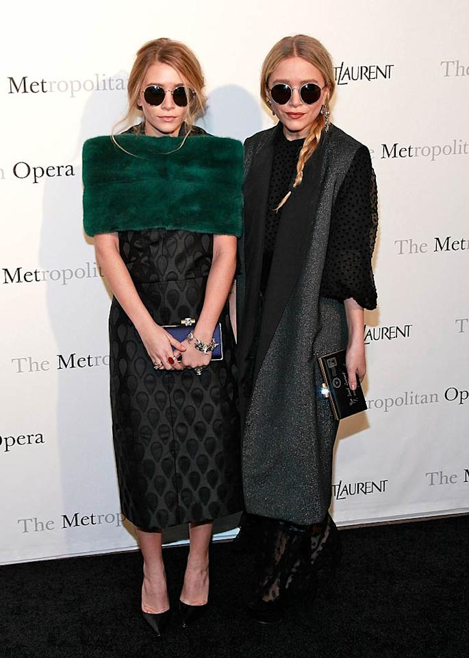 """They may be billionaires, but that doesn't mean wannabe fashionistas Ashley and Mary-Kate Olsen have good taste when it comes to clothing. At the Metropolitan Opera's gala premiere of Rossini's """"Le Comte Ory,"""" Ashley made the mistake of donning an awkward green stole, bedspread-like dress, and overabundance of rings, while MK opted for a black muumuu, sleeveless coat, and a braided ponytail ... and don't get me started on the creepy shades they both sported! Charles Eshelman/<a href=""""http://www.filmmagic.com/"""" target=""""new"""">FilmMagic.com</a> - March 24, 2011"""