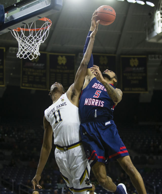 Notre Dame's Juwan Durham (11) and Robert Morris' AJ Bramah (5) fight for a rebound during an NCAA college basketball game Saturday, Nov. 9, 2019 at Purcell Pavilion in South Bend, Ind. (Michael Caterina/South Bend Tribune via AP)