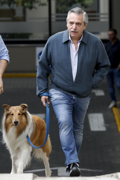 Presidential candidate Alberto Fernandez leaves his home to walk his dog prior to go to vote in presidential elections in Buenos Aires, Argentina, Sunday, Oct. 27, 2019. (AP Photo/Natacha Pisarenko)