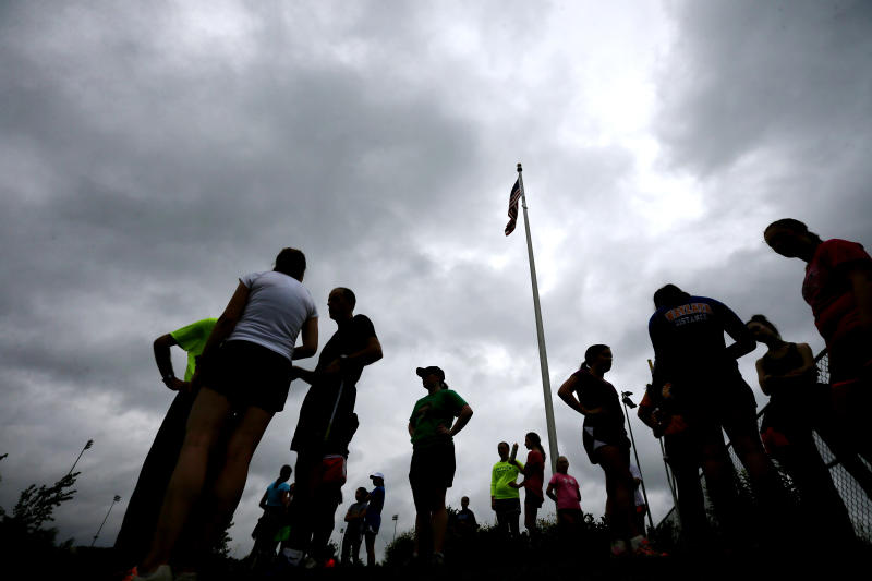 Wayzata High School cross-country team ran in the rainon the first day of practice Monday August 11 , 2014 in Plymouth MN .] Jerry Holt Jerry.holt@startribune.com (Photo By Jerry Holt/Star Tribune via Getty Images)