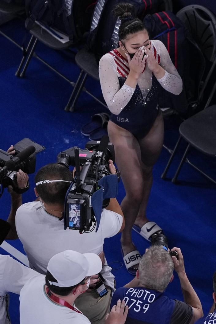 Sunisa Lee, of the United States, reacts as she learns she won the gold medal during the artistic gymnastics women's all-around final at the 2020 Summer Olympics, Thursday, July 29, 2021, in Tokyo. (AP Photo/Morry Gash)