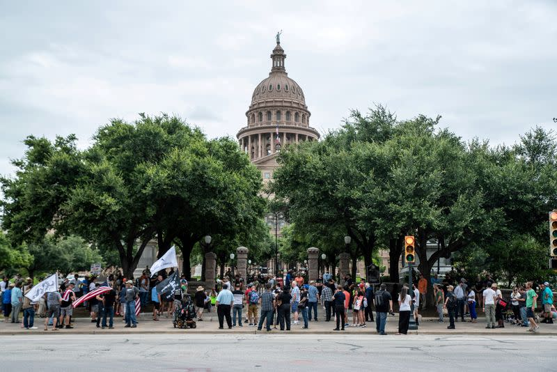 FILE PHOTO: People protest mask mandates in Austin, Texas