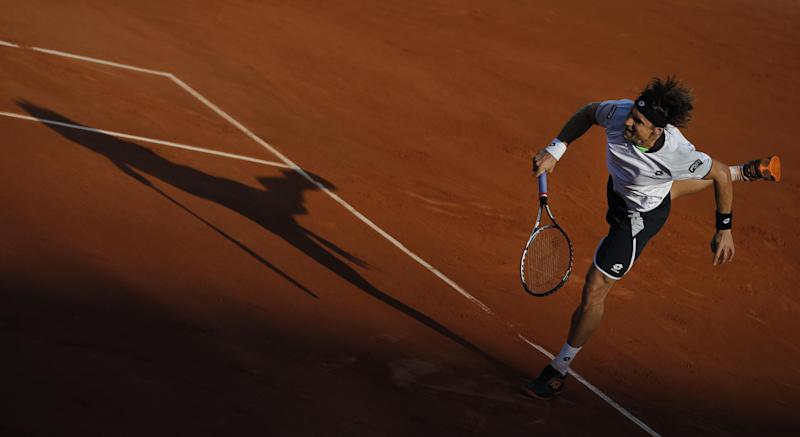 Spain's David Ferrer serves against Jo-Wilfried Tsonga of France in their semifinal match at the French Open tennis tournament, at Roland Garros stadium in Paris, Friday June 7, 2013. (AP Photo/Christophe Ena)