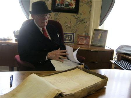 Dudley Martin looks at handwritten manuscripts written by Robert Stroud at his home in Springfield, Missouri, February 12, 2014. REUTERS/Kevin Murphy