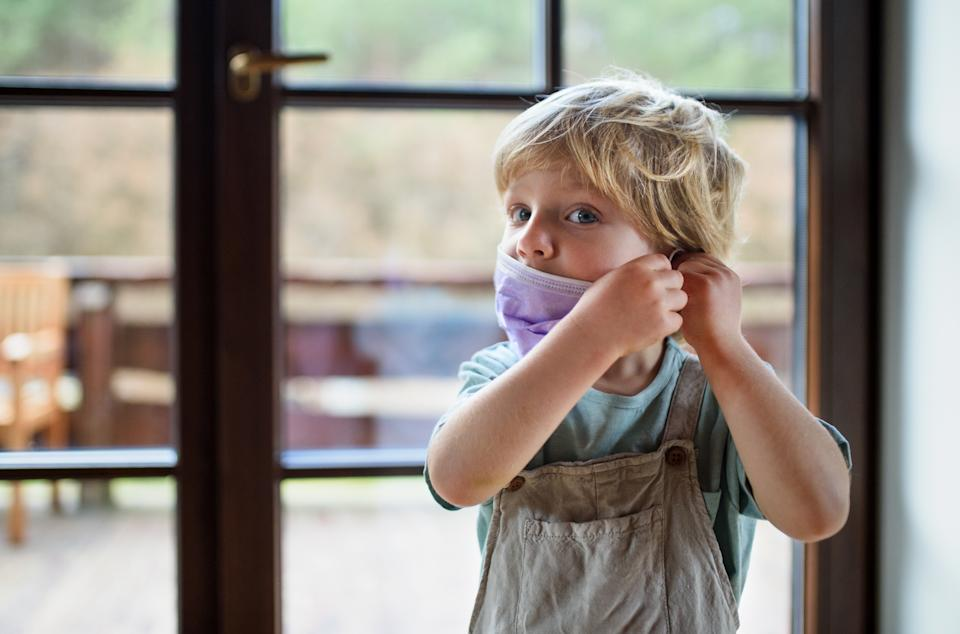 Wearing a mask or face covering can be strange for children. (Getty Images)