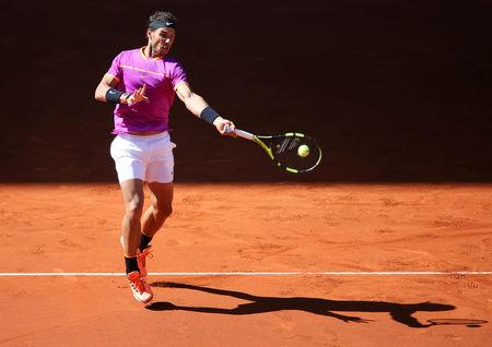 FILE PHOTO: Tennis - ATP 1000 Masters - Madrid Open - Men's Singles Semifinal - Novak Djokovic of Serbia v Rafael Nadal of Spain - Madrid, Spain - 13/5/17 - Nadal plays a forehand. REUTERS/Sergio Perez/File Photo