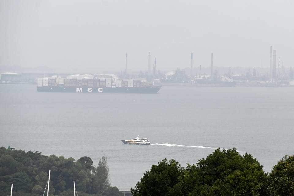 A container ship plies along a hazy western straits of Singapore on 6 August, 2019. (AFP via Getty Images file photo)