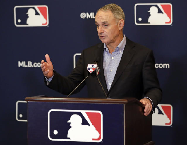 Rob Manfred, commissioner of Major League Baseball, speaks during a news conference at owners meetings Friday, Feb. 8, 2019, in Orlando, Fla. (AP Photo/John Raoux)