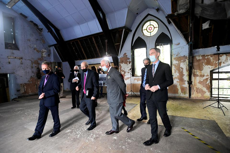 Britain's Prince Charles, Prince of Wales (C), wearing a face covering due to Covid-19, visits the former Merthyr Tydfil Synagogue in Merthyr Tydfil, on May 14, 2021, during his day-long visit to Wales. (Photo by REBECCA NADEN / POOL / AFP) (Photo by REBECCA NADEN/POOL/AFP via Getty Images)
