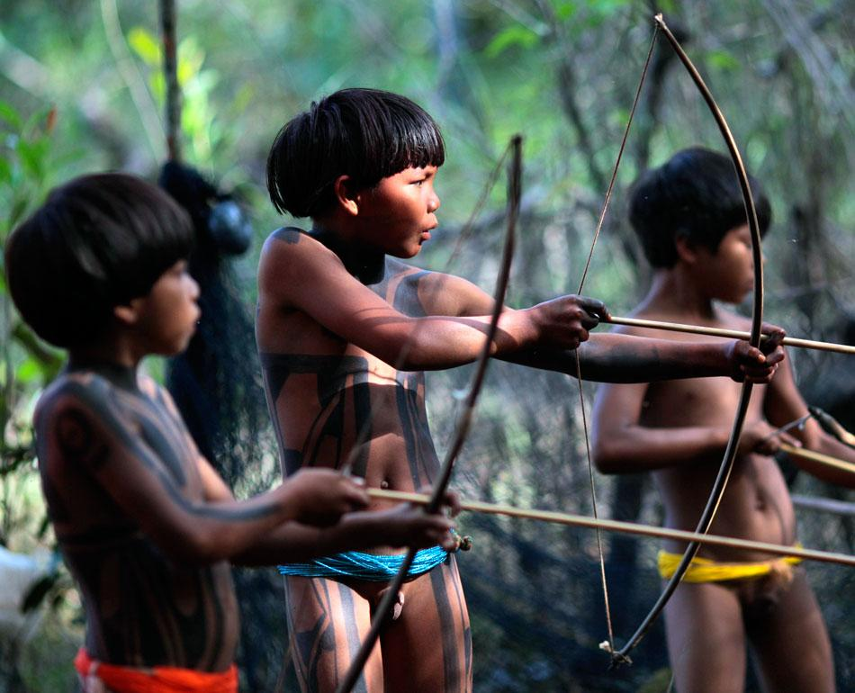 Yawalapiti tribe children attempt to spear fish in the Xingu National Park, Mato Grosso State.