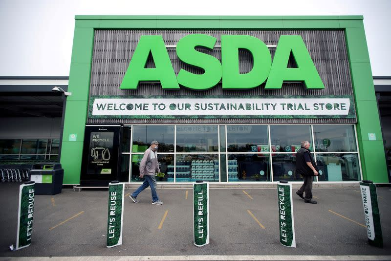 FILE PHOTO: Shoppers walk past the UK supermarket Asda, as the store launches a new sustainability strategy, in Leeds