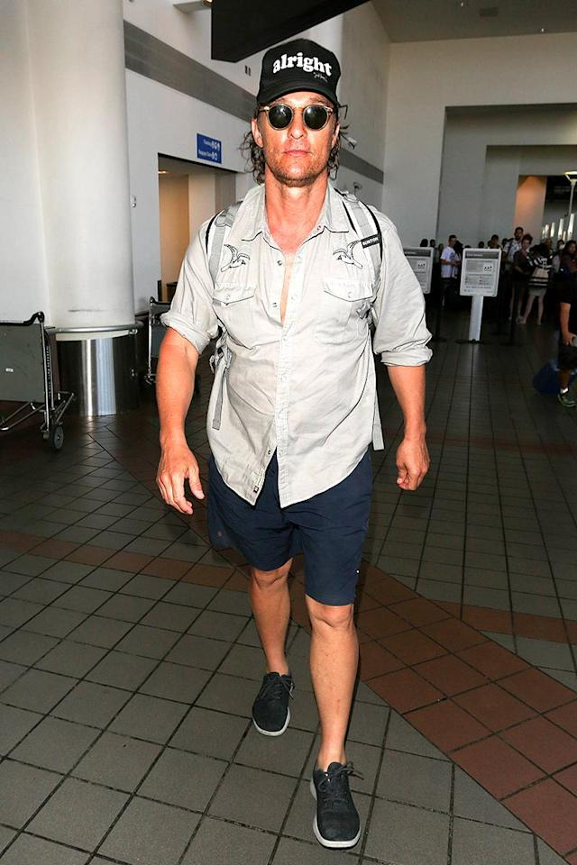 "<p>McConaughey was looking a little less pulled together than usual when he touched down at Los Angeles International Airport, but we know he was still, ""alright."" It's right there on his hat. (Photo: starzfly/Bauer-Griffin/GC Images) </p>"