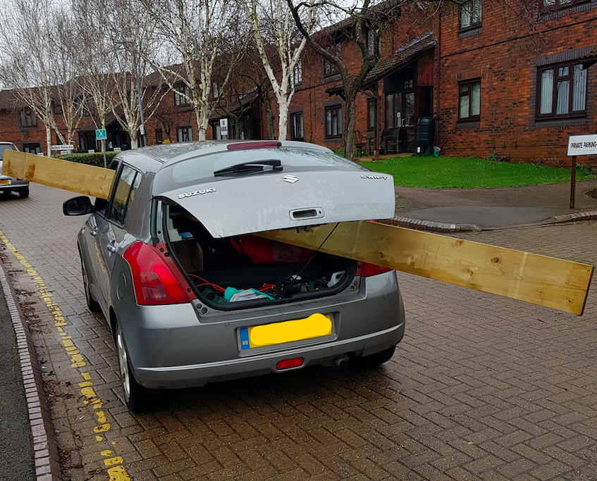 Police discovered the huge plank of wood sticking through the passenger window and protruding out the back of the car. (SWNS)