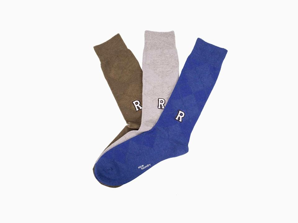 <p><span>Nice Laundry personalized socks</span> ($45 for three pairs) will surely stand out in his sock drawer.</p>
