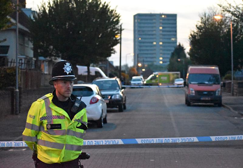 Police at the scene in Wolverhampton where a six-year-old boy was injured when a group of men opened fire on a house with a shotgun. PRESS ASSOCIATION Photo. Picture date: Friday April 19, 2019. The boy is thought to have been inside the house when the shots were fired and he sustained non life-threatening injuries to his back and hand. See PA story POLICE Shotgun. Photo credit should read: Matthew Cooper/PA Wire