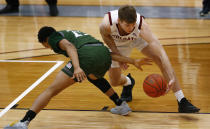 Colgate's Tucker Richardson (15) battles Loyola (Md.) Kenny Jones (25) for a loose ball during an NCAA college basketball game in the finals of the Patriot League tournament, Sunday, March 14, 2021, in Hamilton, N.Y. (AP Photo/John Munson)