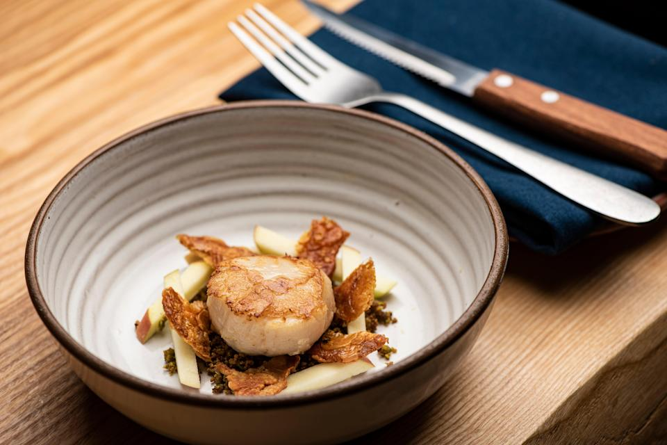 Flawlessly cooked: a scallop in a thick, silty puddle of roasted chicken butter and pistachio sauceDaniel Hambury/Stella Pictures Ltd