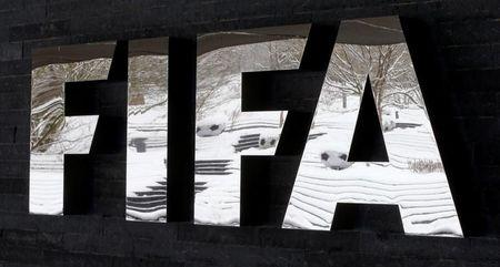 Snow-covered landscape is reflected in a logo in front of FIFA headquarters in Zurich
