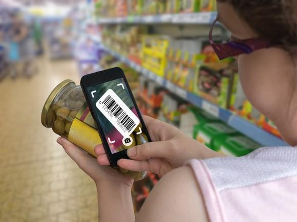 Woman scanning jar in grocery store