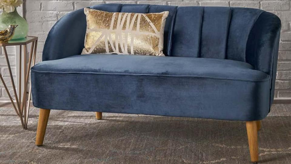 This modern velvet sofa comes in a variety of luxe colors.