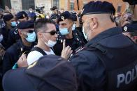 A man is taken away by police during a protest against the government restriction measures to curb the spread of COVID-19, in Rome, Saturday, Oct. 10, 2020. (AP Photo/Andrew Medichini)