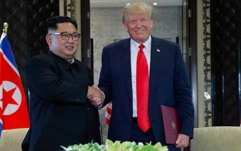 "Donald Trump and Kim Jong-un hold historic meeting US president declares America 'prepared to start new history' North Korean leader 'pledges to destroy major missile test site' The full agreement analysed: what is says and what it means Inside the summit: Stuffed cucumbers and awkward small talk Everything we know so far about the Singapore meeting Tim Stanley: Summit is triumph of charisma over diplomacy Front pages: How the world reacted to long-awaited moment Donald Trump unexpectedly suspended ""war games"" on the Korean peninsula yesterday as he convinced Kim Jong-un to back ""complete denuclearisation"" in a written agreement. The US president said joint US-South Korean military exercises were ""very provocative"" and ""tremendously expensive"", attacking a policy his own administration has pursued until now. Mr Trump also floated the possibility of one day pulling America's tens of thousands of troops out of South Korea, though he said the move was not currently under consideration. Both policy changes have been long-called for by the North Korean government but repeatedly rejected by the Trump administration in the past. The announcements appeared to catch the South Koreans by surprise, with their president's spokesman calling for a ""more clear understanding"" of what Mr Trump meant. Video: Key moments from Trump's Press conference The US has been carrying out joint military exercises for years in the region as a signal of its military alliance with Seoul, and as a show of strength against North Korean aggression. Mr Trump was unapologetic when he revealed the end of ""war games"" in the region, insisting that the North Koreans had given up more than the Americans to reach a deal. The US president said in a press conference after the Singapore summit: ""It is a very great day, it is a very great moment, in the history of the world."" He predicted Kim would start denuclearise ""very quickly"" and revealed that the North Korean leader had already agreed to destroy a missile engine testing site. Historic agreement The climax of Mr Trump's meeting with Kim - the first between a sitting North Korean and American leader - was the signing of a joint agreement. The 400-word statement followed more than four hours of talks, first between the leaders one-on-one and then with a wider group of advisers. It read: ""President Trump and Chairman Kim Jong Un conducted a comprehensive, in-depth, and sincere exchange of opinions on the issues related to the establishment of new US-DPRK relations and the building of a lasting and robust peace regime on the Korean Peninsula. ""President Trump committed to provide security guarantees to the DPRK, and Chairman Kim Jong-un reaffirmed his firm and unwavering commitment to complete denuclearisation of the Korean Peninsula."" Donald Trump speaks to the media in an hour-long Press conference Credit: SAUL LOEB /AFP The Democratic People's Republic of Korea, or DPRK, is an alternative name for North Korea. The statement went on to list four specific pledges that both Mr Trump and Kim agreed to stand by. The first was that both countries would establish ""new relations"" in the pursuit of ""peace and prosperity"" - an attempt to draw a line under the insults and threats of last year. The second said that America and North Korea would ""join their efforts to build a lasting and stable peace regime on the Korean Peninsula"". The third said that Kim's regime ""commits to work toward complete denuclearisation of the Korean Peninsula"" - a key demand from the Americans. And the fourth promised that the remains of fallen US soldiers who died fighting in the Korean War would be repatriated to the United States. The hand of friendship? Kim Jong-un pats Donald Trump on the back as the pair leave the signing ceremony Credit: SAUL LOEB /AFP Concerns emerge Mr Trump touted the agreement as ""very comprehensive"" and said that denuclearisation was ""going to happen"" at a press conference yesterday. However critics questioned how watertight the assurances written in the agreement were and whether they were detailed enough. The phrase ""complete, verifiable, irreversible denuclearisation"" did not appear in the document, despite the Americans insisting Kim agree to the objective. There were also no specific promises about exactly what parts of his nuclear programme Kim would give up or when. Signed and sealed: Donald Trump shows the document he and Kim Jong-un put their names to in Singapore Credit: JONATHAN ERNST /Reuters There is also the issue that Pyongyang frequently refers to denuclearisation of the ""Korean Peninsula"", which would imply disarmament on all sides. Mr Trump warned that denuclearisation takes a ""long time scientifically"" and repeatedly refused to give a timetable for developments. However he said that economic sanctions would not be lifted nor a new US embassy established in Pyongyang until there was proof of denuclerisation. Both the Americans and the North Koreans have committed to future talks, which will be led on the US side by Mike Pompeo, the secretary of state. Mr Trump said he ""absolutely"" would invite Kim to the White House and expressed enthusiasm for visiting North Korea, but said no dates had been set. Tremendous relationship Mr Trump hailed his ""tremendous"" relationship with Kim and said he believed he could trust the North Korean leader after the pair met in Singapore. The US president said their talks were ""honest, direct and productive"", adding: ""We got to know each other well in a very confined period of time."" Asked if he trusted Kim, Mr Trump replied: ""I do."" Pushed to explain, Mr Trump said: ""I know when someone wants to deal and I know when they don't."" Trump-Kim summit in pictures: Best photos from Donald Trump and Kim Jong-un's meeting in Singapore Throughout the day both leaders displayed surprisingly warm body language towards each other, given that they spent most of the last year trading insults and threats. At numerous points during the summit they were seen patting each other on the back or arm, smiling and laughing together and sharing compliments. Mr Trump said Kim was ""very talented"", noting how he had taken over the North Korean leadership while still in his twenties - though acknowledging that Kim had ""run it tough"". Mr Trump said: ""Anyone can make war but only the most courageous can make peace."" He later said in an interview about Kim: ""He's got a great personality. He's a funny guy, he's very smart, he's a great negotiator. He loves his people, not that I'm surprised by that."" Human rights Mr Trump revealed he had discussed North Korea's human rights record ""relatively briefly"" with Kim but came under pressure to show he took the issue seriously. A 2014 report from a United Nations Human Rights Council commission found the regime had committed multiple violations including arbitrary detention, torture [and] executions. Asked about human rights, Mr Trump said: ""It was discussed relatively briefly compared to denuclearisation … They will be doing things. I think he wants to do things."" History in the making: Kim Jong-un and Donald Trump look at each other before signing the document Credit: JONATHAN ERNST /Reuters Reporters repeatedly pressed the president to square his praise for the North Korean leader with what was happening in the country, including the imprisonment of political dissidents. Mr Trump mentioned Otto Warmbier, the US college student who was imprisoned in North Korea and died shortly after his return to America last year. The US president praised the relatives of Mr Warmbier and wondered whether the progress in talks could have happened without the tragedy, which cast a spotlight on the regime. Elsewhere in his hour-long press conference, Mr Trump said he hoped an end to the Korean War, which is technically still running 68 years after it begun, could be secured soon. Mr Trump also praised the leaders of Japan, South Korea and China as well as Kim himself for the progress made on the issue of denuclearisation. Korea summit 