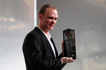 Tour de France 2017 winner Chris Froome of Britain poses with the Golden bike trophy he received during the presentation of the itinerary of the 2018 Tour de France cycling race in Paris, France, October 17, 2017. REUTERS/Charles Platiau/Files