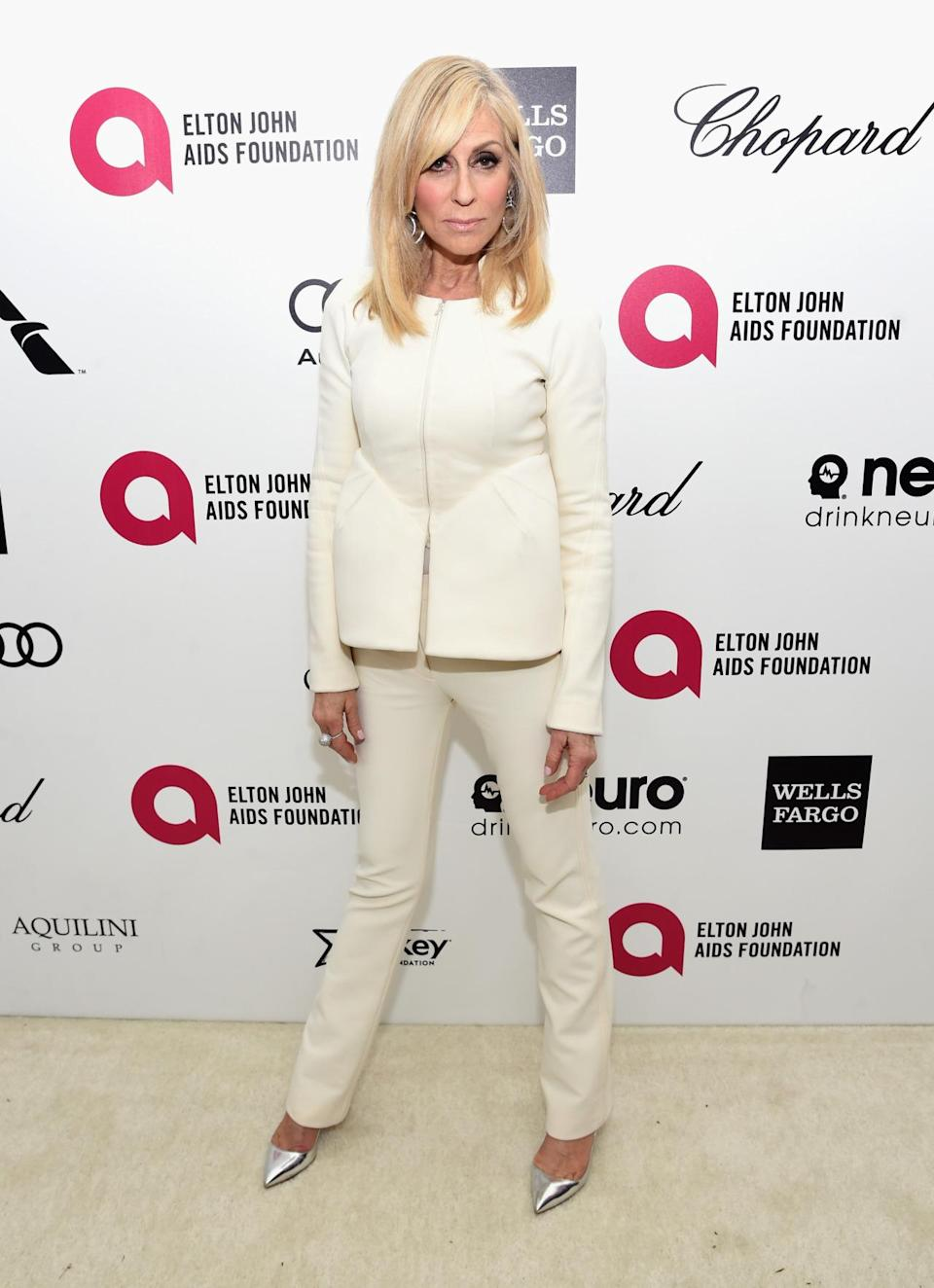 The Transparent star at 66 is bringing sexy back (or did it ever really go away) in a cream suit, silver heels, and bombshell blowout.