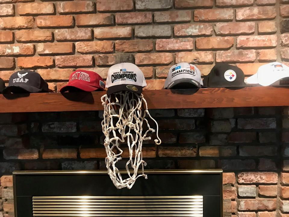 On a shelf in Bill and Donna Frese's home in Cedar Rapids, Iowa, Bill has displayed the net Brenda gave him after Maryland won the 2021 Big Ten conference tournament title.