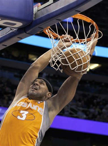 Phoenix Suns forward Jared Dudley dunks during the first half of an NBA basketball game against the Orlando Magic, Wednesday, March 21, 2012, in Orlando Fla. (AP Photo/Reinhold Matay)