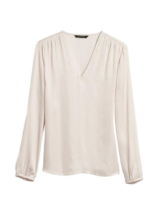"""<p>Elevate your workwear with one of the season's fresh new spins on a tried-and-true classic—the white blouse. Whether you opt for a new silhouette or an updated design detail like an angel sleeve, these options make a white top look anything but basic.</p> <p><em>Soft Satin Smocked Blouse</em><br /> Button cuffs and balloon sleeves add flair to this satin blouse, making it a workwear staple that easily transitions from day to night. This top fits in just as well in the office as it does on date night.<br /><strong>To buy: </strong>$80; <a href=""""http://www.anrdoezrs.net/links/7876406/type/dlg/sid/RS%2CThisFallCapsuleWardrobeMakesGettingDressedWayEasier%2Cnorlingh%2CCLO%2CGAL%2C548989%2C201909%2CI/http://bananarepublic.gap.com/browse/product.do?pid=493509002&pcid=999#pdp-page-content"""" target=""""_blank"""">bananarepublic.com</a>.</p> <p><em>Mango Satin Button Up Shirt</em><br /> Tailored for an airy but flattering fit, this creamy beige, menswear-inspired classic is a chic update to the standard white button-down.<br /><strong>To buy: </strong>$60; <a href=""""http://www.anrdoezrs.net/links/7876406/type/dlg/sid/RS%2CThisFallCapsuleWardrobeMakesGettingDressedWayEasier%2Cnorlingh%2CCLO%2CGAL%2C548989%2C201909%2CI/http://shop.mango.com/us/women/shirts-plain/satin-shirt_53073755.html"""" target=""""_blank"""">mango.com</a>.</p> <p><em>Halogen Wrap Front Peplum Top</em><br /> For a dressier twist on the white shirt, opt for this crepe blouse with a wrapped silhouette and flouncy peplum.<br /><strong>To buy: </strong>$79; <a href=""""https://click.linksynergy.com/deeplink?id=93xLBvPhAeE&mid=1237&murl=http%3A%2F%2Fshop.nordstrom.com%2Fs%2Fhalogen-wrap-front-peplum-top-regular-petite%2F5196678&u1=RS%2CThisFallCapsuleWardrobeMakesGettingDressedWayEasier%2Cnorlingh%2CCLO%2CGAL%2C548989%2C201909%2CI"""" target=""""_blank"""">nordstrom.com</a>.</p>"""