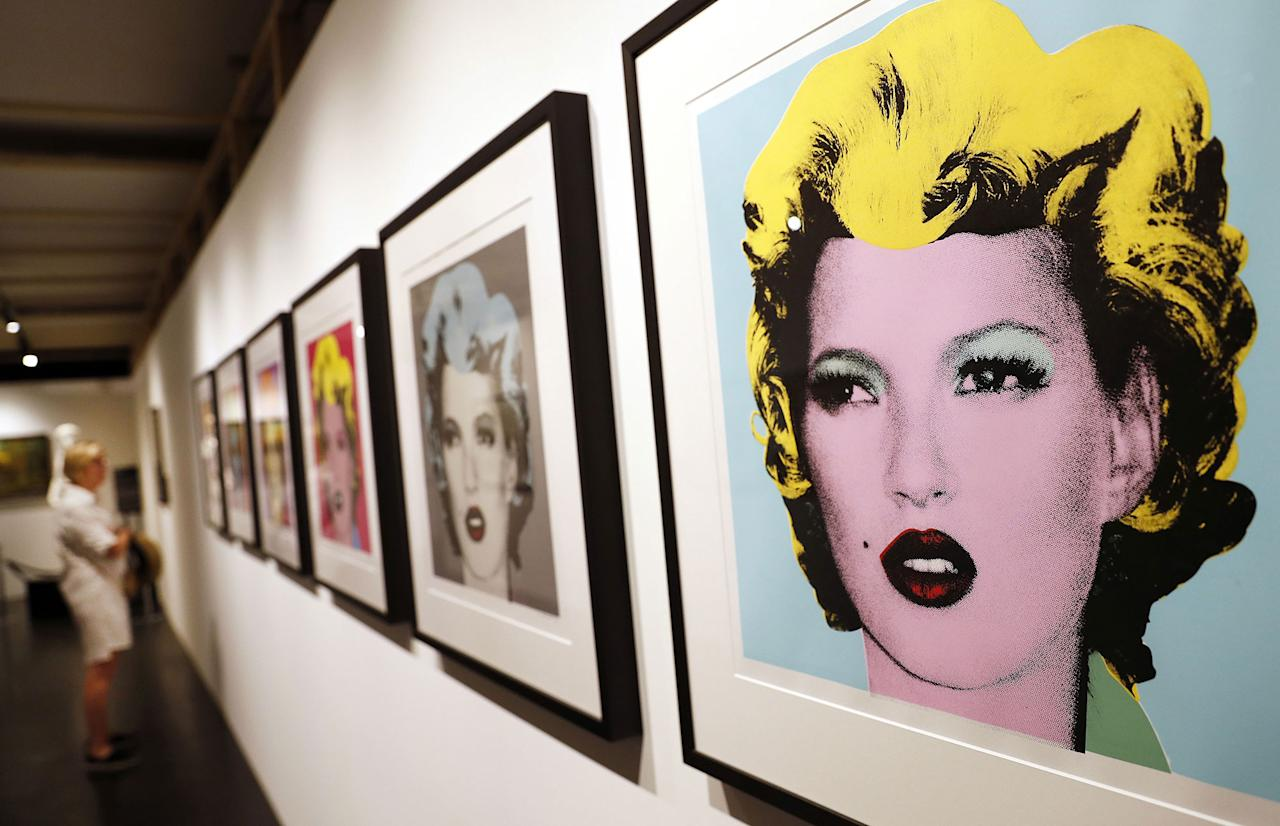 <p>A visitor observes a group of screenprints entitled 'Kate Moss' by British Banksy during the exhibition 'The Art of Banksy' in Berlin, Germany on June 20, 2017. (Felipe Trueba/EPA/REX/Shutterstock) </p>