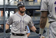 Colorado Rockies' Daniel Murphy (9) is greeted after crossing home plate on his three-run home run off Pittsburgh Pirates starting pitcher Montana DuRapau during the first inning of a baseball game in Pittsburgh, Wednesday, May 22, 2019. (AP Photo/Gene J. Puskar)