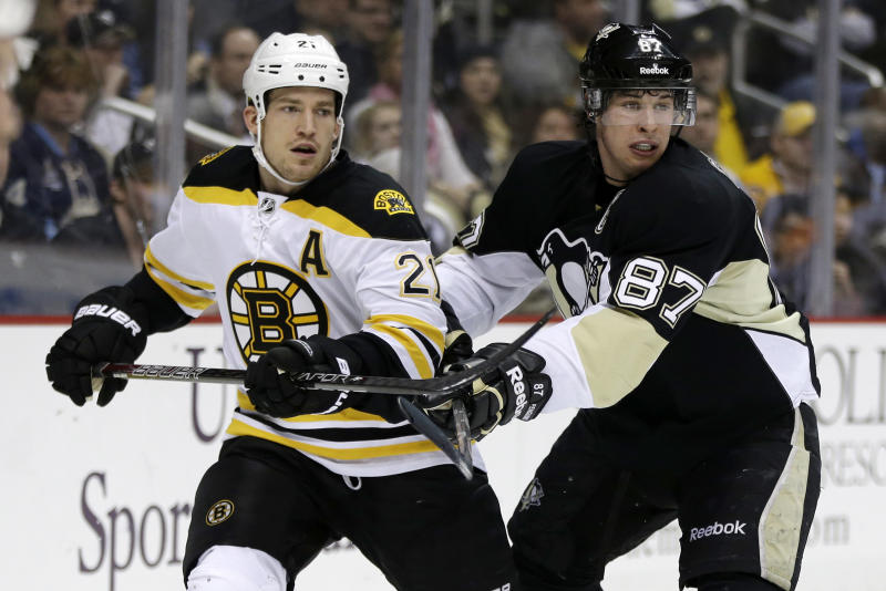 In this March 12, 2013, photo, Pittsburgh Penguins center Sidney Crosby (87) checks Boston Bruins defenseman Andrew Ference (21) during an NHL hockey game in Pittsburgh. The Edmonton Oilers have signed former Bruins defenseman Ference to a four-year deal. Ference's deal is reportedly worth $13 million, and he would count $3.25 million against the salary cap. (AP Photo/Gene J. Puskar)