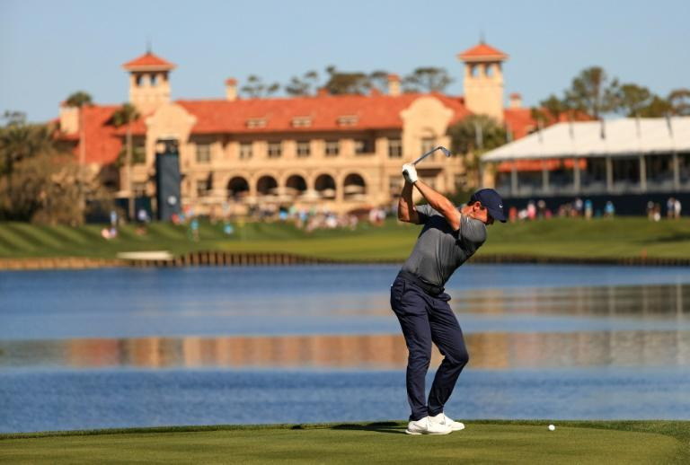 Northern Ireland's Rory McIlroy plays from the drop zone after hitting his tee shot into the water at 18 in the first round of the US PGA Tour Players Championship