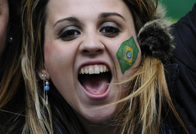 a Brazilian fan cheers before the 2011 Copa America Group B first round football match between Brazil and Venezuela at the Ciudad de La Plata stadium in La Plata, 59 Km south of Buenos Aires, on July 3, 2011. (Photo credit should read DANIEL GARCIA/AFP/Getty Images)
